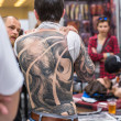 Постер, плакат: Unidentified participants at International Tattoo Convention