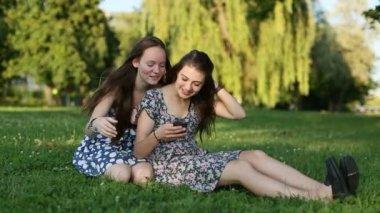 Two pretty girlfriends doing selfie — Stock Video