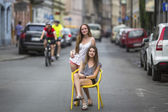 Teenage girls in street of old town — Stock Photo