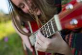 Young  girl playing on acoustic guitar. — Stock Photo