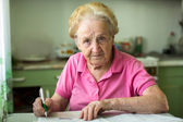 Elderly senior woman and  bills notices — Stock Photo