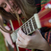 Girl playing on acoustic guitar. — Stock Photo