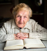 Grandmother  with  big book. — Stock Photo