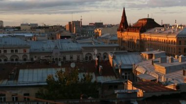 Top view over the roofs of the old center of St. Petersburg during an amazing sunset. — Stock Video
