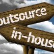 Outsource x In-house creative sign with clouds as the background — Stock Photo #53541461