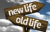 New Life x Old Life creative sign with clouds as the background — Stock Photo