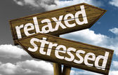 Relaxed x Stressed creative sign with clouds as the background — Stock Photo