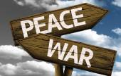 Peace x War creative sign with clouds as the background — Stok fotoğraf