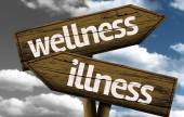 Wellness x Illness creative sign with clouds as the background — Stock Photo
