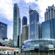 Urban landscape of Singapore. Skyline and modern skyscrapers of business district Marina Bay Sands at most financial developing Asian city state. — Stock Photo #54763045