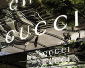 Gucci signage at store entrance. Gucci is an Italian fashion label owned by French company PPR. Gucci was founded by Guccio Gucci in Florence in 1921. — Stock Photo