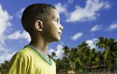 Brazilian boy at tropical background — Stock Photo