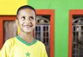 Little Brazilian boy smiling in a colorful background — Stock Photo