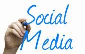 Social Media hand writing with a blue mark on a transparent board — Stock Photo