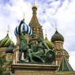 Monument to Minin and Pozharsky on the Red Square in Moscow Russia. Saint Basil's Cathedral on the background. — Stock Photo #57492973
