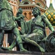 Monument to Minin and Pozharsky on the Red Square in Moscow Russia. Saint Basil's Cathedral on the background. — Stock Photo #57587409