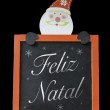 Christmas Blackboard written Merry Christmas (Portuguese: Feliz Natal) — Stockfoto #57647909