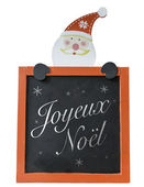 Christmas Blackboard written Merry Christmas (French: Joyeux Noel) — Stock Photo