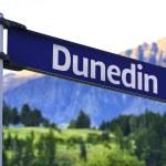 Dunedin sign on a beautiful landscape background — Stock Photo #57650575