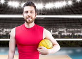 Volleyball player on red uniform on volleyball court. — Foto de Stock