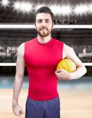 Volleyball player on red and blue uniform on volleyball court. — Foto de Stock
