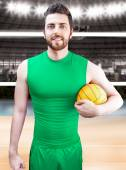 Volleyball player on green uniform on volleyball court. — Stockfoto