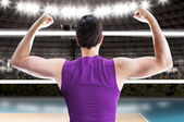 Volleyball player on purple uniform on the volleyball court. — Stock Photo