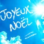 Happy Christmas (French: Joyeux Noel) written on a beautiful sky — Stock Photo #58583591