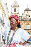 BAHIA, BRAZIL - CIRCA NOV 2014: A Brazilian woman of African descent, smiling, wearing traditional clothes from the state of Bahia in the old colonial district of Salvador (Pelourinho). — Stock Photo