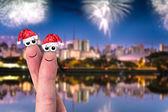 Cute couple finger in christmas theme on the city — Foto de Stock