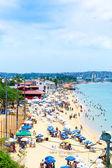 BAHIA, BRAZIL - CIRCA NOV 2014: People enjoy a sunny day at Boa Viagem Beach in Bahia, Brazil. — Stock Photo