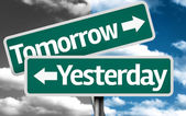 Tomorrow x Yesterday creative sign with clouds as the background — Stock Photo