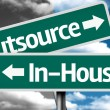 Outsource x In-house creative sign with clouds as the background — Stock Photo #59032121