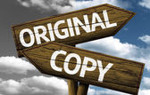 Original x Copy creative sign with clouds as the background — Stock Photo