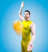 Volleyball player on yellow uniform on blue background. — Stockfoto