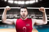 American volleyball player celebrates on red uniform on volleyball court. — Stock fotografie