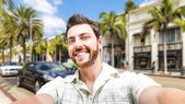 Happy young man taking a selfie photo in Los Angeles, USA — Stock Photo