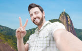 Happy young man taking a selfie photo in Rio de Janeiro, Brazil — Stock Photo