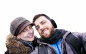 Beautiful Couple taking a selfie photo on white background. — Stockfoto