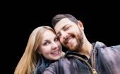 Beautiful Couple taking a selfie photo on black background — Stock Photo