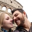 Happy young romantic couple traveling in Italy, Europe in front of Colosseum in Rome, Italy — Stock Video #62640587
