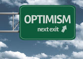 Optimism, next exit creative road sign — Stock Photo
