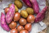 Some potatoes, onions and sweet potatoes — Stock Photo