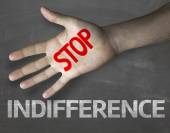 Stop Indifference on the blackboard — Stock Photo