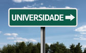 """University"" written in Portuguese creative sign — Stock Photo"