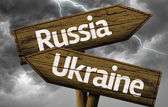 Russia and Ukraine wooden sign — Stock Photo