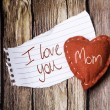 I Love You Mom on paper and a heart — Stock Photo #62880279