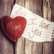 I Love You Mom on paper and a heart — Stock Photo #62887159