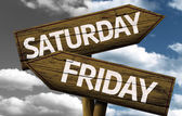 Saturday x Friday On wooden sign — Stock Photo