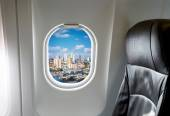 Buildings through aircraft window — Stock Photo